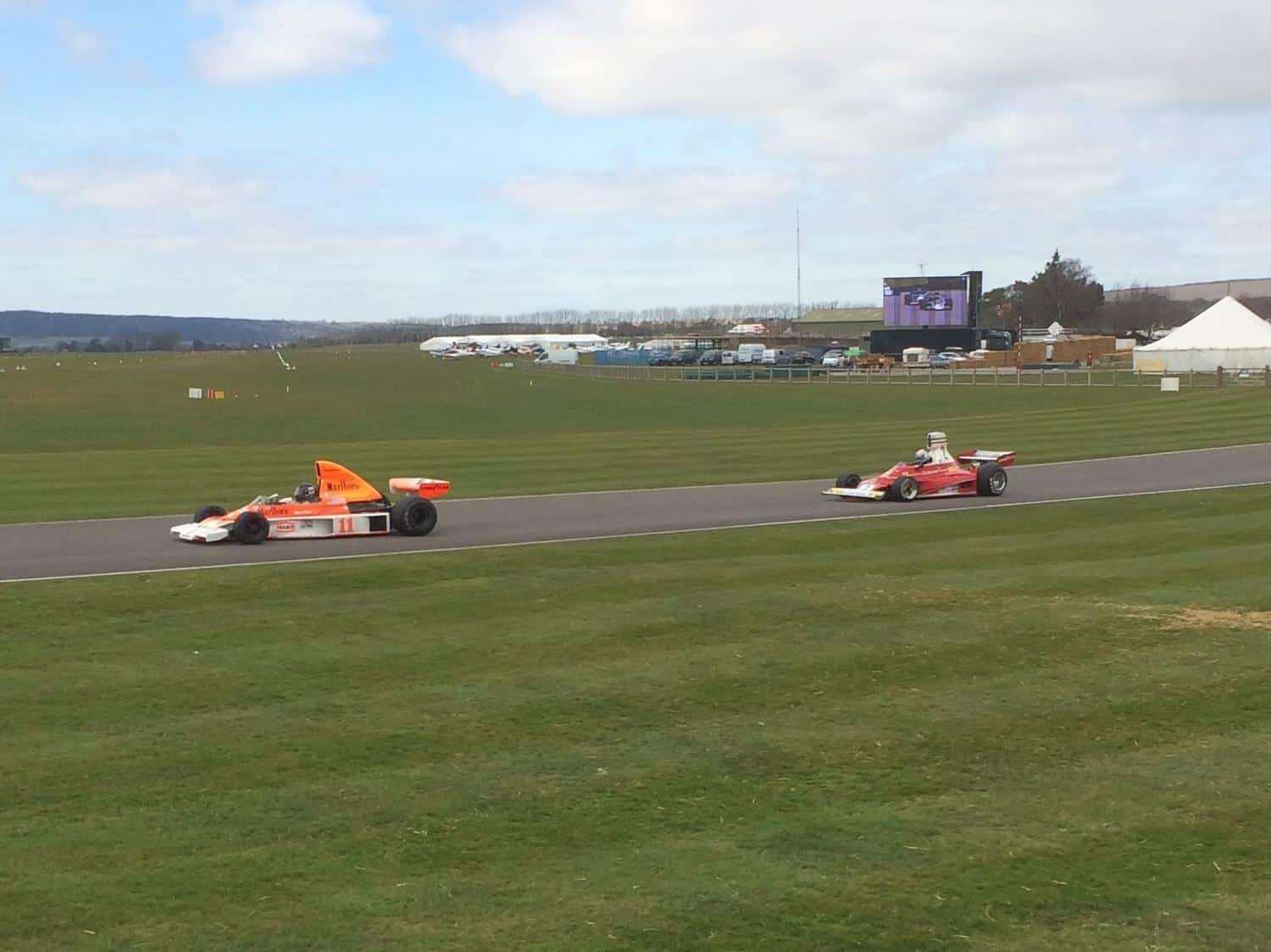 It's 1976 all over again! A McLaren M23 leads a Ferrari 312T in a demonstration run at the 73rd Goodwood Members' Meeting
