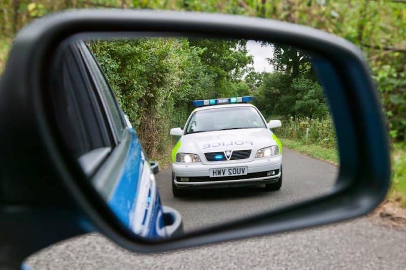 Emergency vehicle in mirror