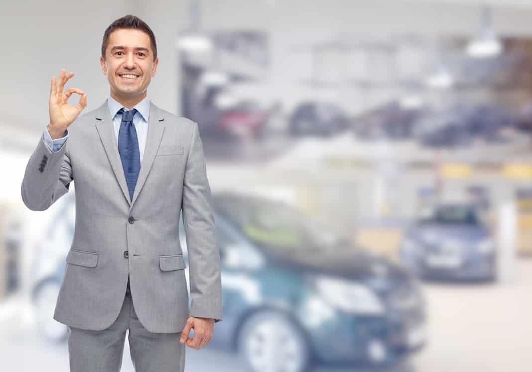 Car salesman in showroom