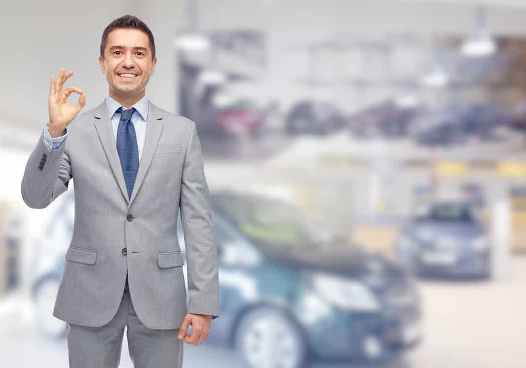 Car salesman in showroom