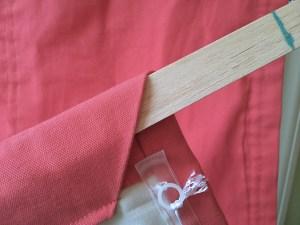 wooden slat in bottom hem