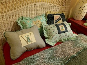 A small very firm pillow can be a sleepy-time comfort to a child. Add an appliqué to a DIY toddler pillow with envelope pillow case and piping edge.