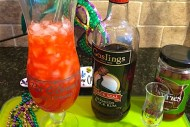 Hurricane cocktail is a fruity passion fruit and rum drink. Invented in New Orleans, it's a great Mardi Gras libation!