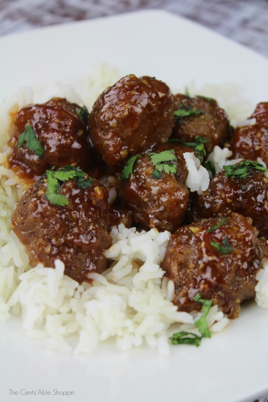 Fresh meatballs, wrapped in a tangy, kicked up sauce - delicious over rice, or served as an appetizer! #meatballs #appetizer #easydinner #instantpot #crockpot