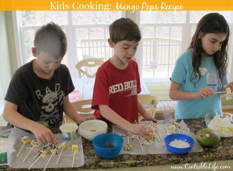 Kids making mango pops