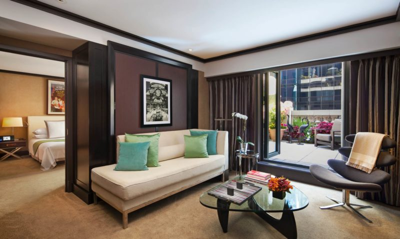 hotel with living room pain ideas luxury manhattan collection in nyc the chatwal a suite white couch blue and green pillows an exit