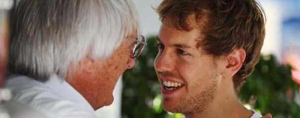 Bernie Ecclestone congratulates Sebastian Vettel on a brilliant year - Photo Credit: Clive Mason/Getty Images