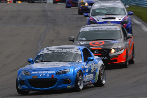 The #5 ModSpace MX-5 leads a pack into turn one at The Glen (Credit: CJ Wilson Racing)