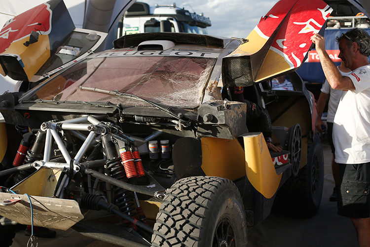 The broken Peugeot 2008 DKR of Loeb and Elena - Credit: DPPI / Red Bull Content Pool