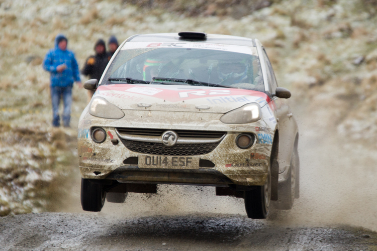 The Vauxhall Adam R2 jumps on a gravel rally stage.