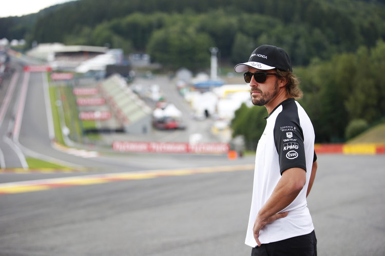 Fernando Alonso surveys Eau Rouge from the side of the track. Credit: McLaren Media Centre
