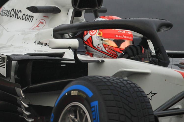 Kevin Magnussen drives his Haa F1 car on wet tyres