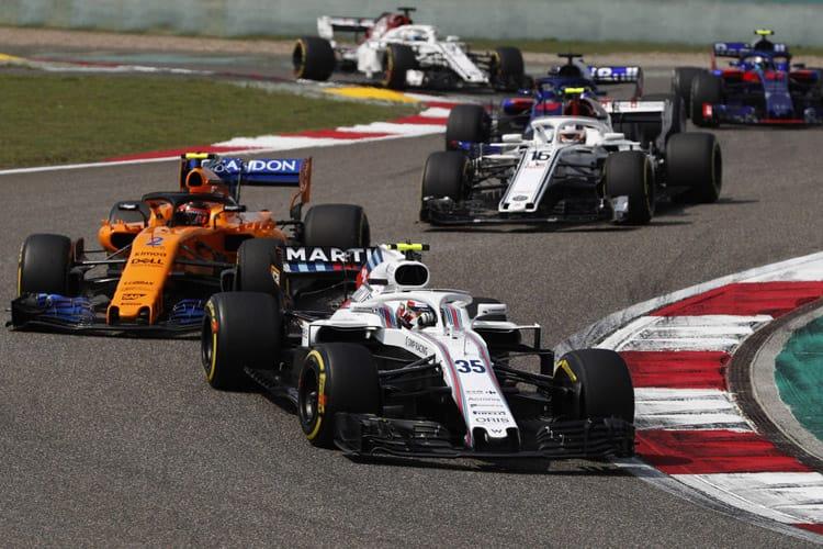 Sergey Sirotkin drives through China's second corner