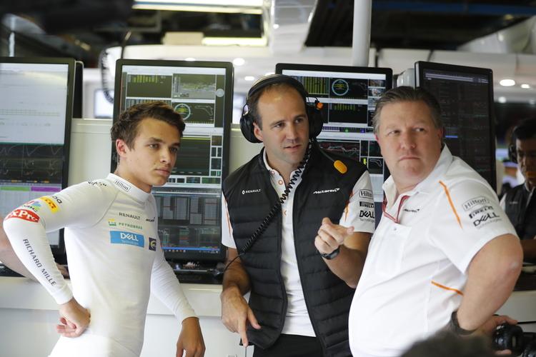 Monza, Italy. Friday 31 August 2018. Lando Norris, McLaren, with Tom Stallard, Engineer, McLaren, and Zak Brown, Executive Director, McLaren Technology Group.