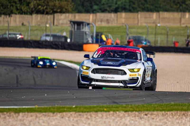 The #15 Multimatic Motorsports Mustang at Coppice on the Donington Park Grand Prix circuit.