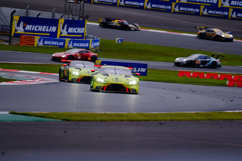 Aston Martin Racing #97 leading the class-leading #95 Aston Martin on track at Fuji Speedway