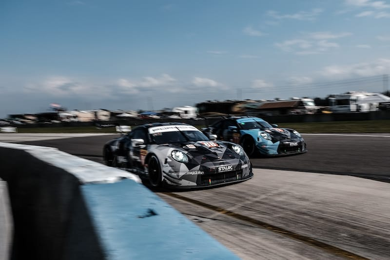 Dempsey-Proton Racing Porsche 911s racing on track at Sebring