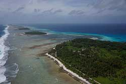 Aerial photograph of Kwajalein Atoll showing its low-lying islands and coral reefs.