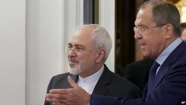 Russian Foreign Minister Sergey Lavrov, right, welcomes his Iranian counterpart, Mohammad Javad Zarif, at their meeting in Moscow, Russia, Aug. 17, 2015.