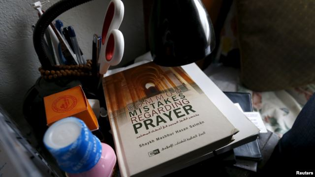 A book is shown inside the home of suspects Syed Rizwan Farook and Tashfeen Malik in Redlands, Calif., Dec. 4, 2015, following Wednesday's attacks in San Bernardino.
