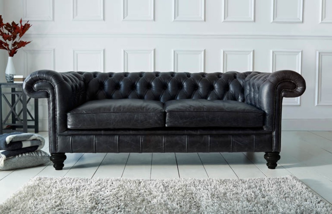 contemporary living room with black leather sofa canvas wall art paxton chesterfield | company