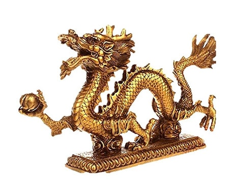 golden dragon statue - symbol for money andd luck in the year of the dog 2018