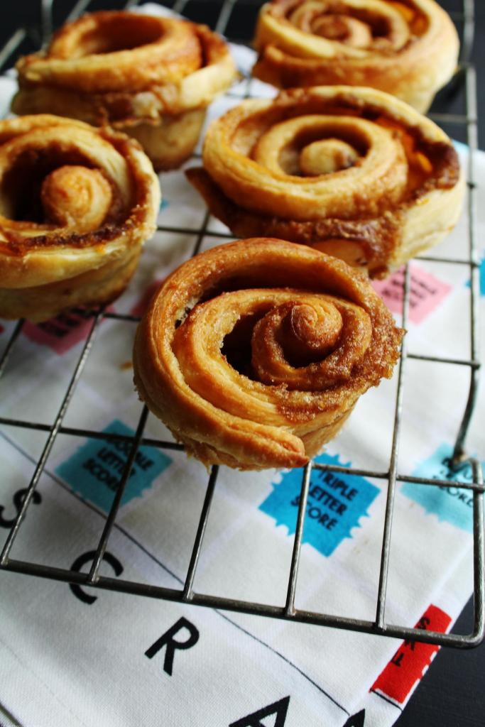 Light and flaky cinnamon morning buns made from an easy croissant dough. Like a cinnamon roll but lighter and more buttery, these are sublime straight out of the oven. I love this recipe because you get a flaky buttery dough that is super easy to make!
