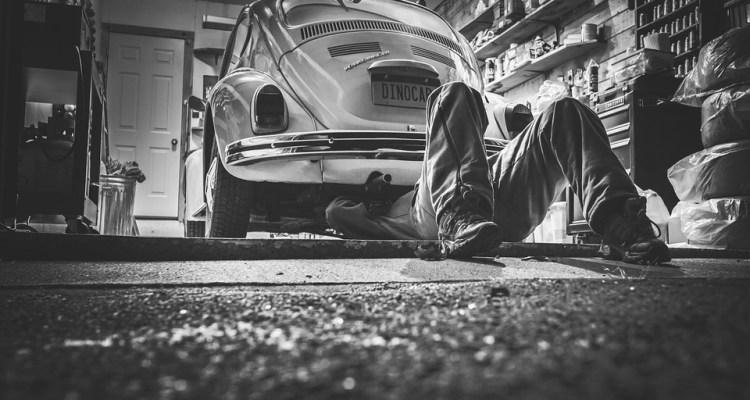 mechanic repairing vehicle