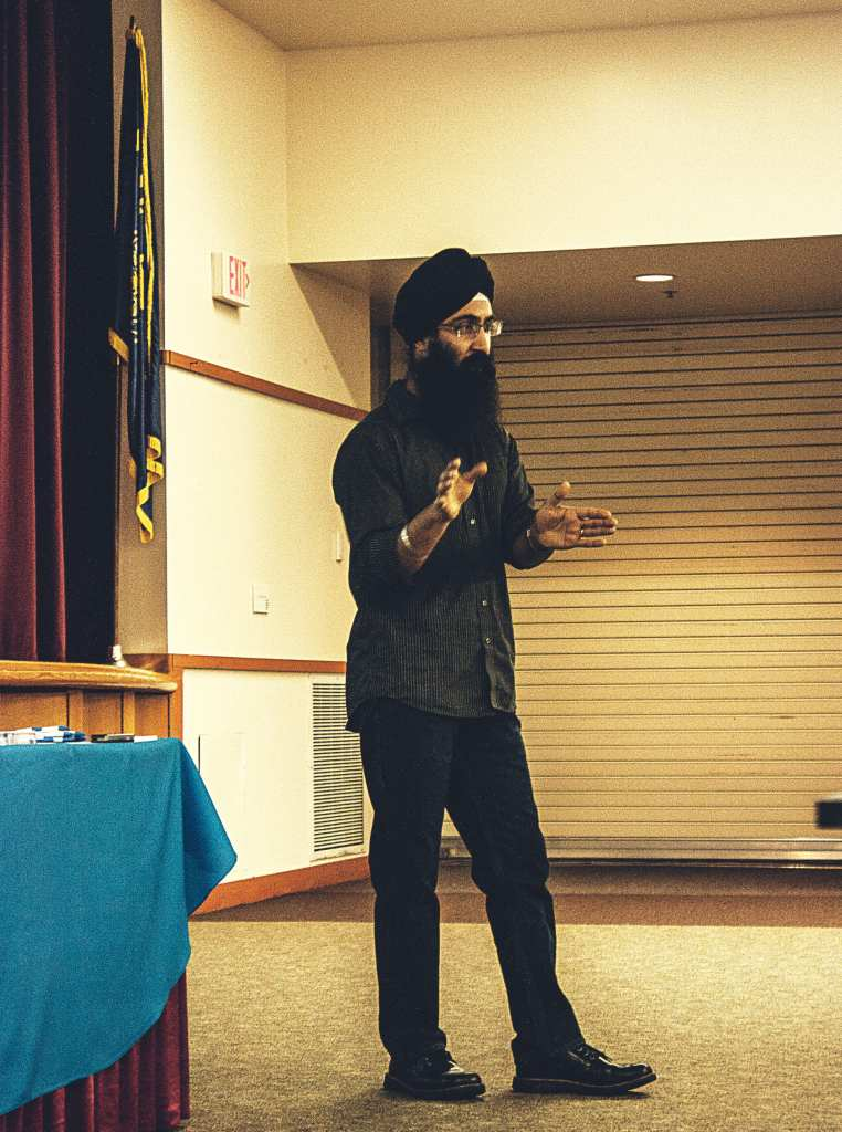 Daman Oberoi, an Intel employee, speaks about the internship opportunities for students in the Gregory Forum on Nov. 23.