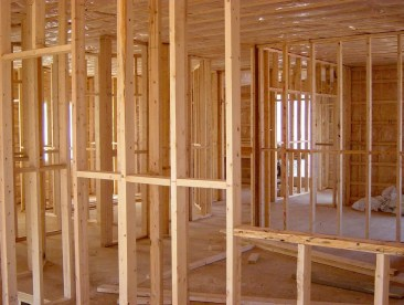 a house in the framing stage of construction how to easily read a tape measure and tape measure increments