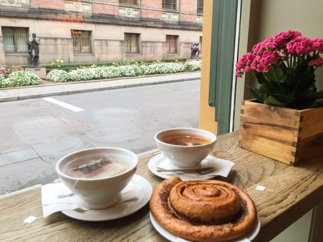 48 Hours in Oslo Cinnamon roll and tea by the window at cafe in Oslo Norway