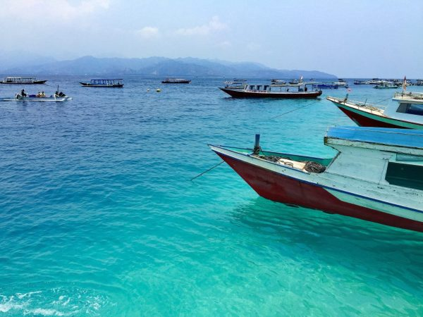 Slow boats in the Southeast Asia ocean - How to Spend Less Than $50 A Day in Bali