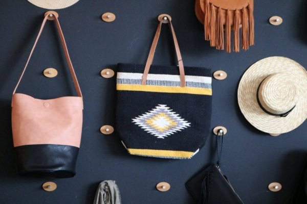 Shop wall purse and hat Create & Cultivate Los Angeles