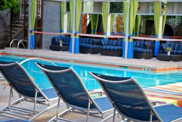 Outdoor pool lounge chairs Clarendon Hotel and Spa