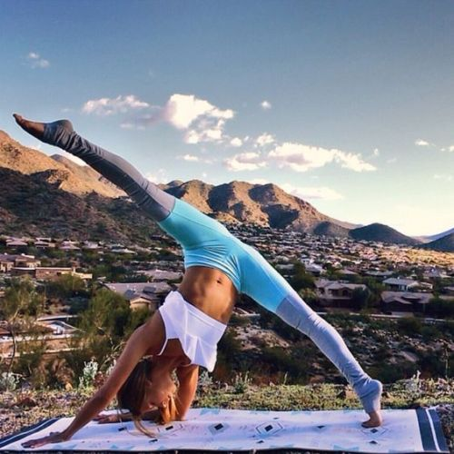 Travel When You Have a Bad Back; girl stretching and yoga outside