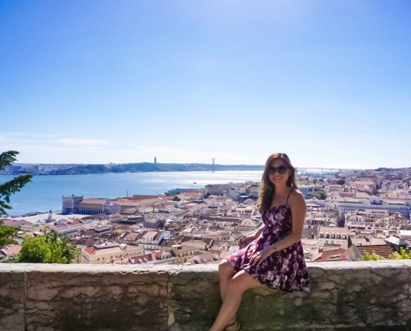 Meet Clumsy Traveler Christine; brunette in black dress over Europe
