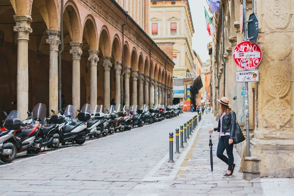Meet Clumsy Traveler Rachel; girl looking down the street of Bologna