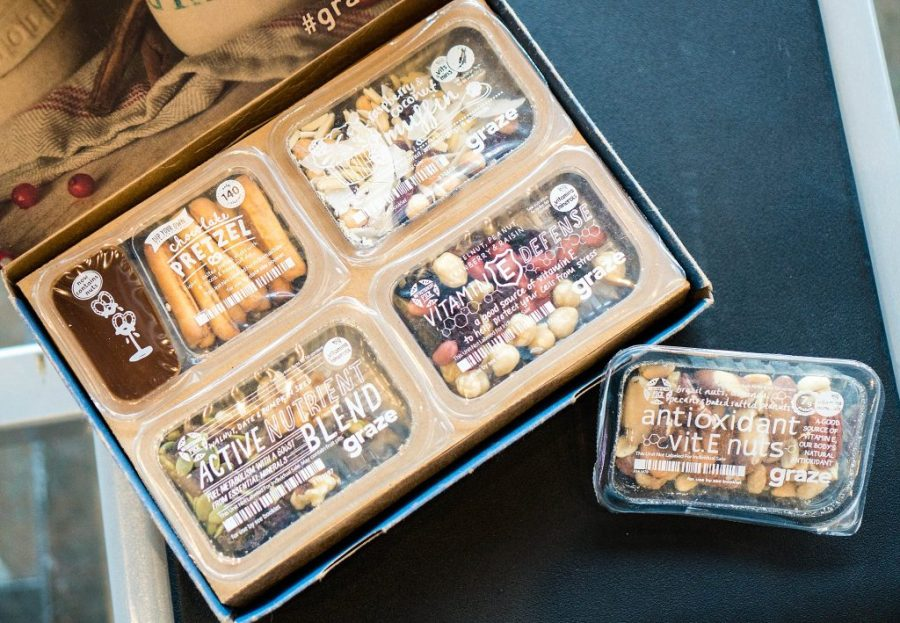 How to Save Money on Food While Traveling; graze box with snacks