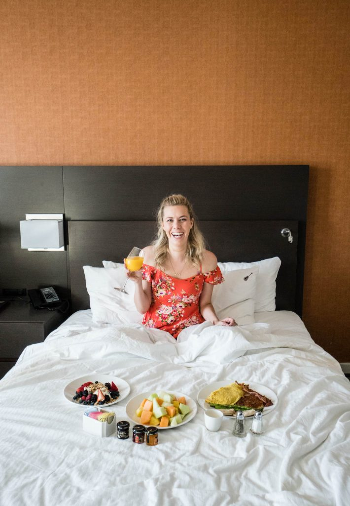Staying at the Hard Rock Hotel San Diego; girl with room service