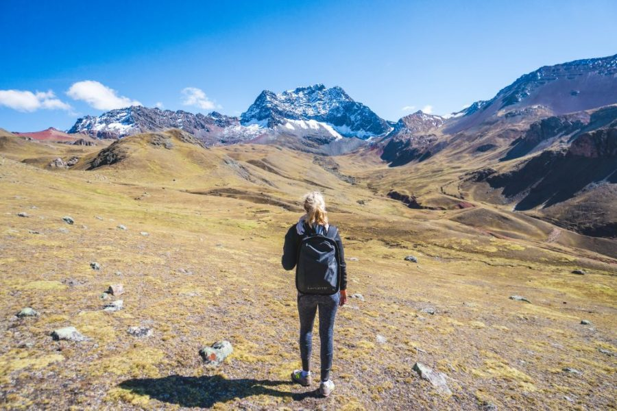 traveling with HYLETE; girl hiking rainbow mountain in Peru