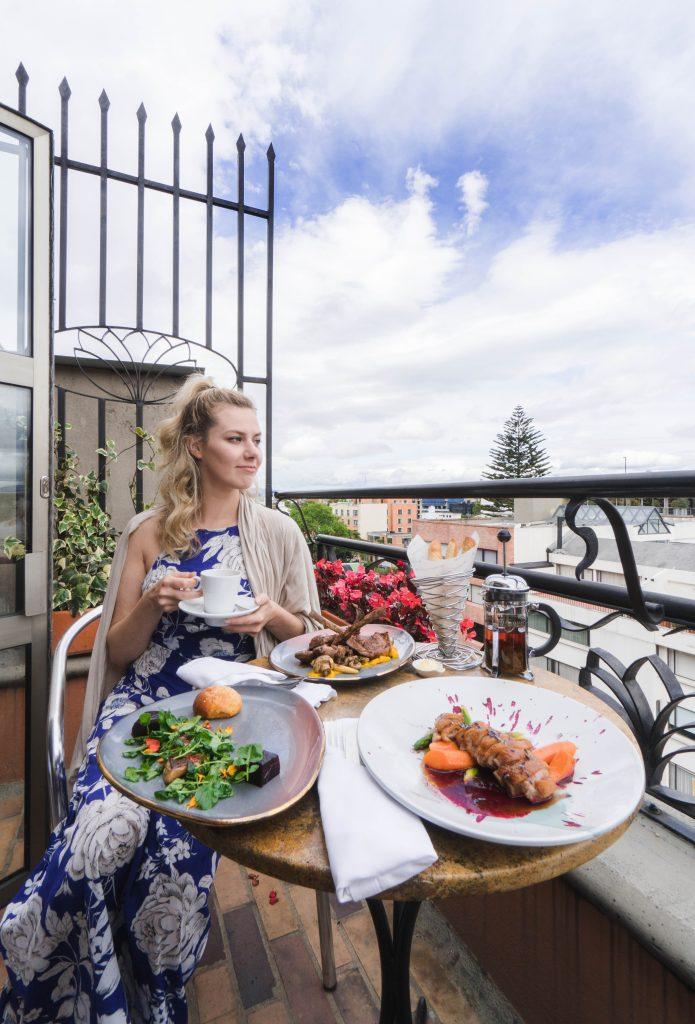Staying at Sofitel Bogota; breakfast lunch on balcony girl blonde