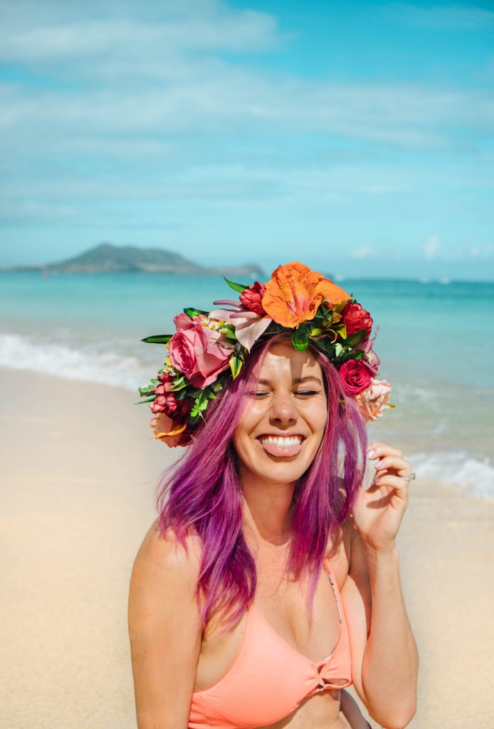 2017 was the best; purple hair girl laughing on the beach with hawaiian flower crown