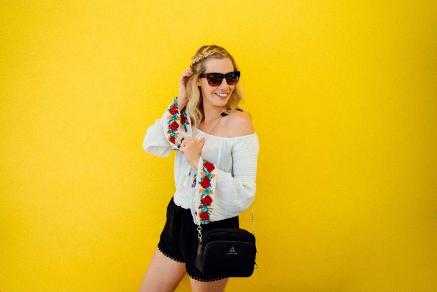 best anti theft purse; girl The Clumsy Traveler with black cross body bag Arden Cove