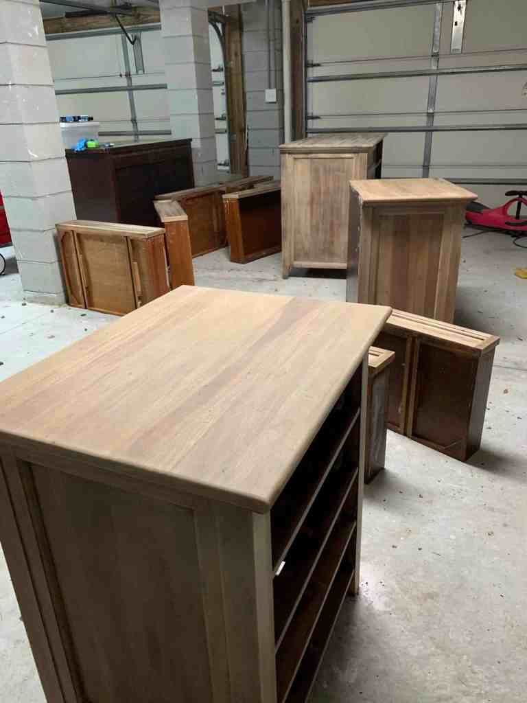 How to strip and bleach furniture to obtain a raw wood finish.  This tutorial transforms stained and painted furniture into natural wood furniture and gives them a new look.  #refinishingfurniture #refinishedfurniture #citristrip #naturalfinish #rawwood #bleachingfurniture