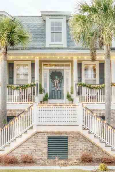 Christmas home tour featuring a coastal home with garland and minimal decor.