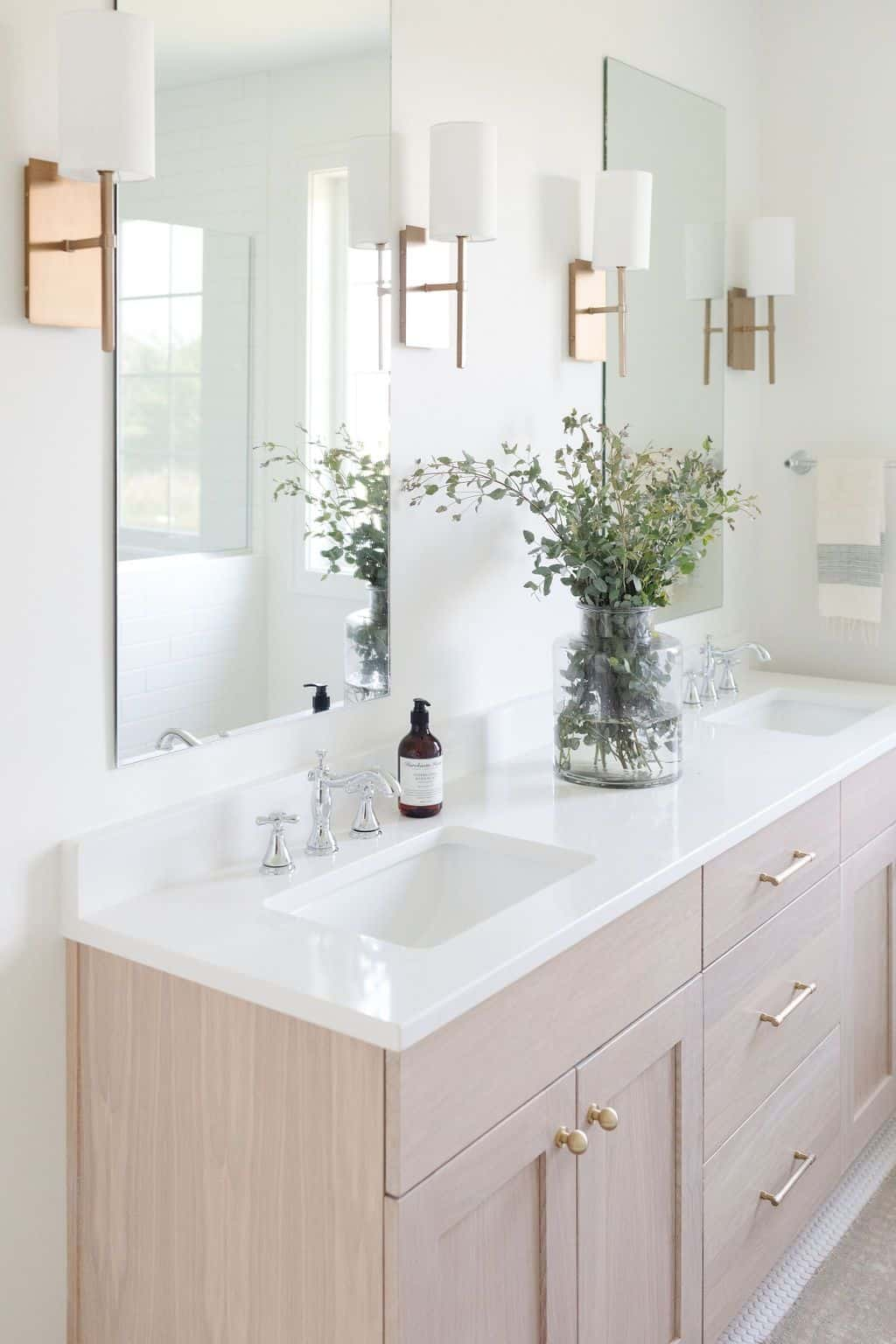 natural wood vanity with brass accents