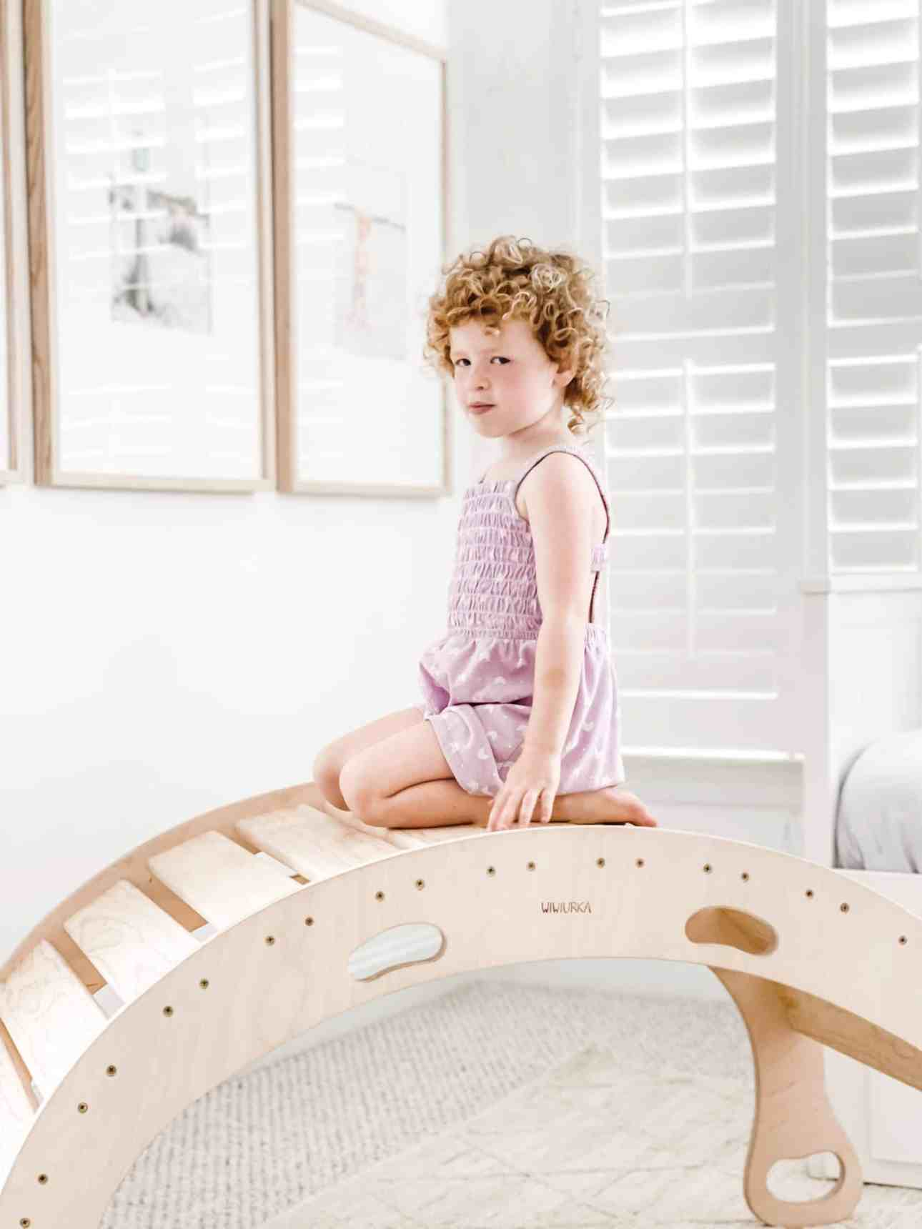 Wood climbing toy in playroom.