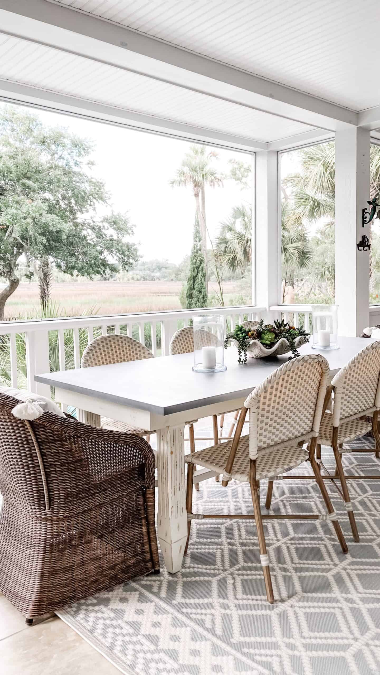 Outdoor space with blue diamond rug from Boutique Rugs.