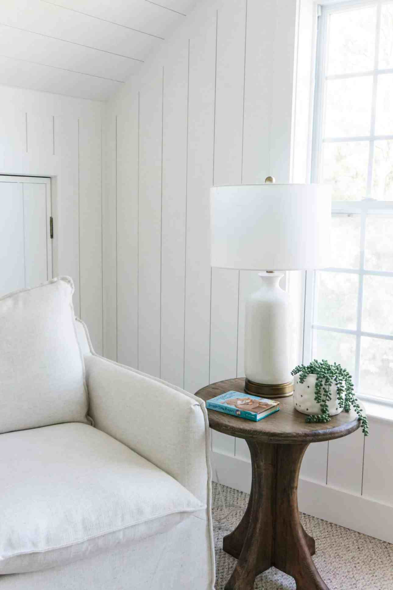 Nursery with rocker and glider and shiplap walls.