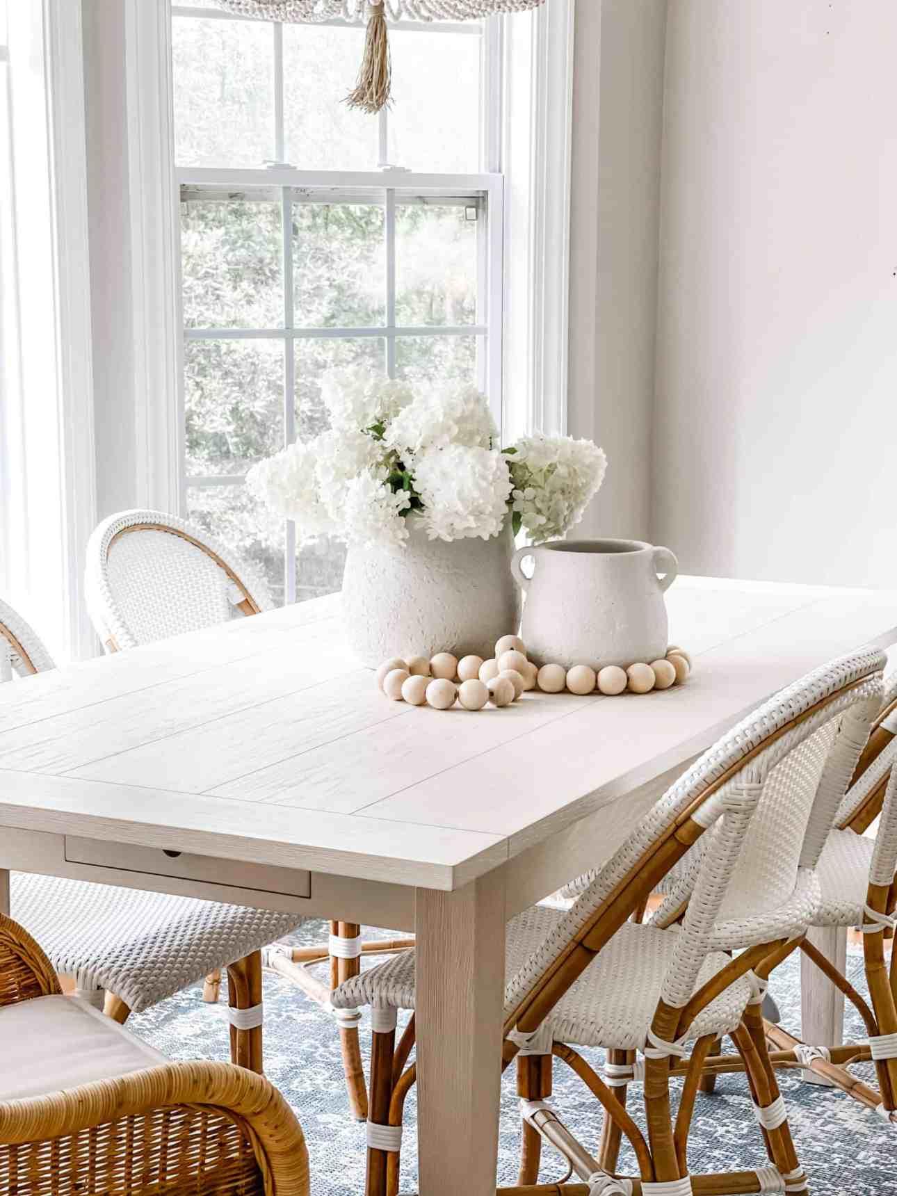 Placing white wedding hydrangeas in vases.